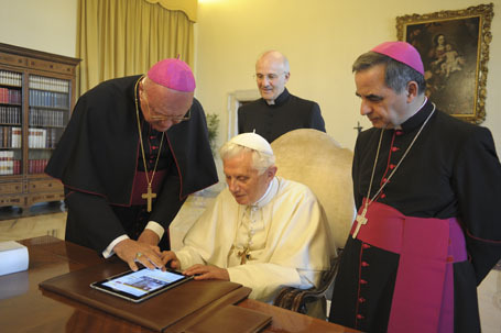 Pope Benedict XVI checks the new Vatican web portal on an iPad device at the Vatican